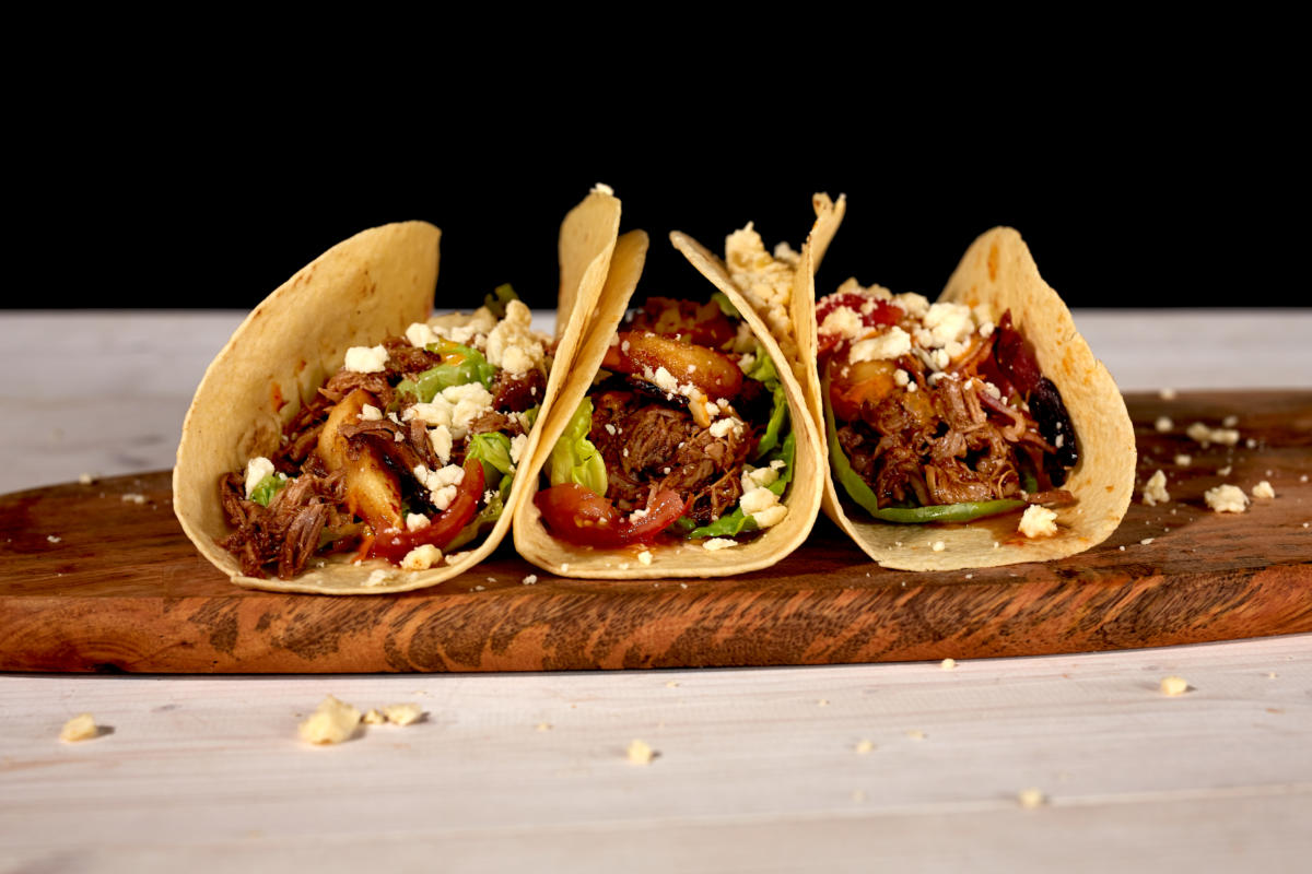Pulled Pork Tacos with Caramelised Apple, Crispy Bacon & Yorkshire Wensleydale Cheese